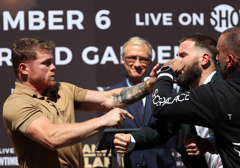 Beverly Hills, CA - SEPTEMBER 21: (LR) Canelo Alvarez slaps Caleb Plant during a pre-match press conference before their middleweight fight on November 6 at the Beverly Hilton Hotel on September 21, 2021 in Beverly Hills, California.  (Photo by Ronald Martinez/Getty Images)