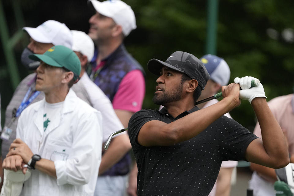 Tony Finau watches his tee shot on the sixth hole during the third round of the Masters golf tournament on Saturday, April 10, 2021, in Augusta, Ga. (AP Photo/Charlie Riedel)