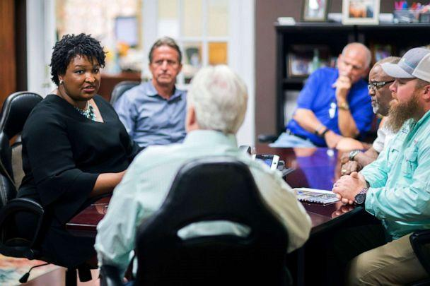 PHOTO: Georgia Democratic gubernatorial candidate Stacey Abrams meets with a group of employees at the Coastal Solar office during a campaign stop to announce her 'Jobs for Georgia Plan', July 26, 2018, in Hinesville, Ga. (Stephen B. Morton/AP)
