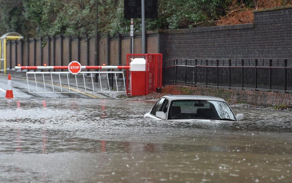 A car is submerged by rising floodwater in St Helens, Lancashire - Richard Long/News Images