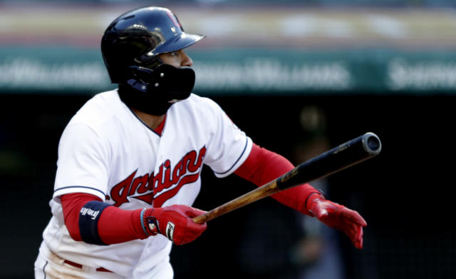 Cleveland Indians' Francisco Lindor watches his ball after hitting a double off Kansas City Royals starting pitcher Ian Kennedy in the sixth inning of a baseball game, Saturday, April 7, 2018, in Cleveland. (AP Photo/Tony Dejak)