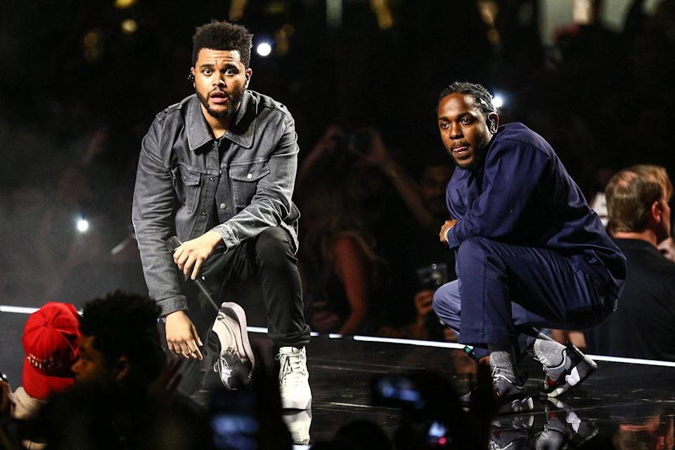<p>The Weeknd on stage with Kendrick Lamar</p>Rich Fury/The Forum via Getty