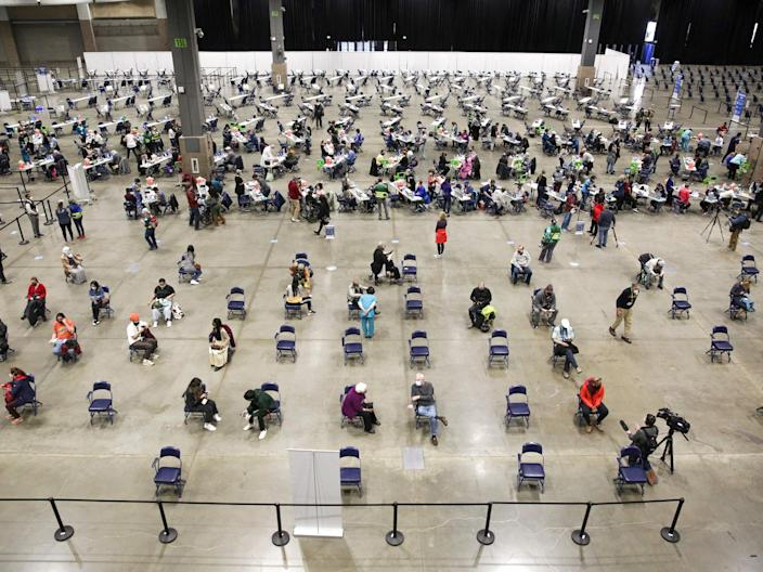 Patients sit in an observation area after receiving the Pfizer Covid-19 vaccine on March 13, 2021, in Seattle, Washington.  (AFP via Getty Images)