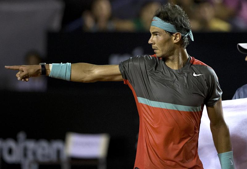 Rafael Nadal, of Spain, gestures during his match with Albert Montanes, of Spain, at the Rio Open tennis tournament in Rio de Janeiro, Brazil, Thursday, Feb. 20, 2014. (AP Photo/Silvia Izquierdo)