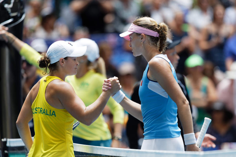 France's Kristina Mladenovic, right, shakes hands with Australia's Ash Barty during their Fed Cup tennis final in Perth, Australia, Sunday, Nov. 10, 2019. (AP Photo/Trevor Collens)