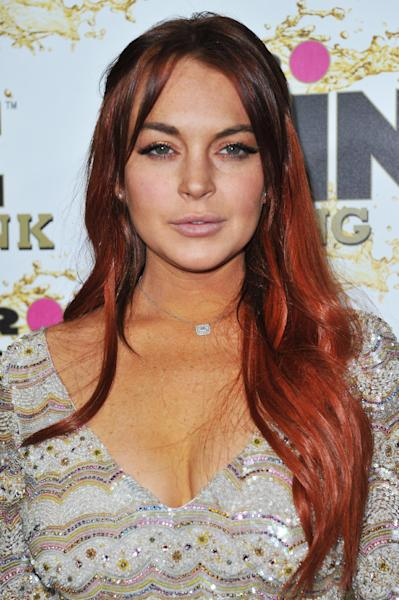 FILE - In this Oct. 11, 2012 file photo, Lindsay Lohan attends the Mr. Pink Ginseng launch party at the Beverly Wilshire hotel in Beverly Hills, Calif. Lohan is due to be arraigned on Wednesday, Dec. 12, 2012 on three misdemeanor charges filed after authorities say they determined the actress lied about being a passenger when her Porsche slammed into the back of a dump truck in June. (Photo by Richard Shotwell/Invision/AP, File)