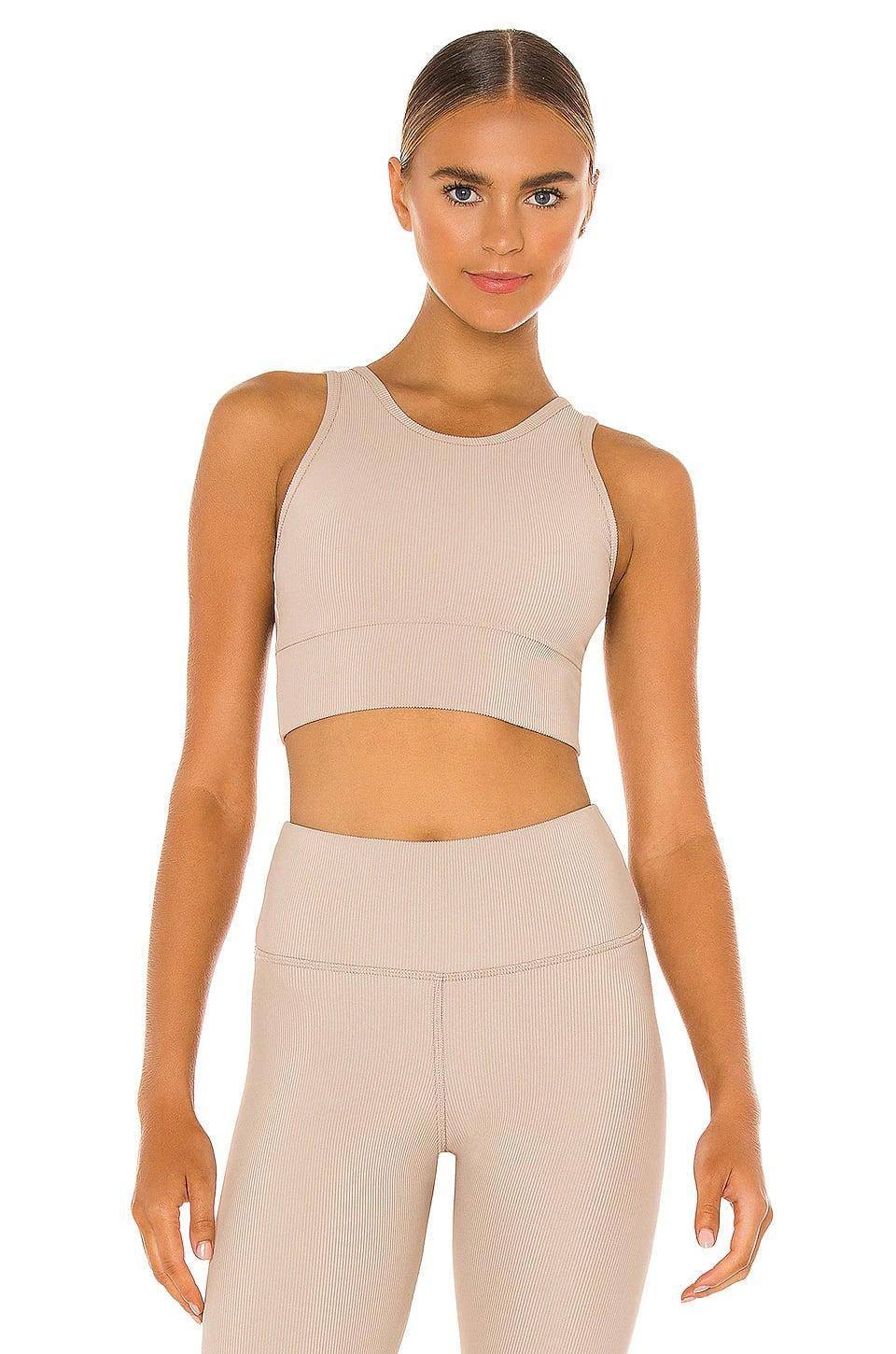 <p>Go neutral with this <span>Strut-This Piper Sports Bra</span> ($68) and <span>Kendall Ankle Legging</span> ($88). It's flattering, sweat-wicking, and will make you feel like summer all year long.</p>
