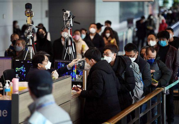 PHOTO: Passengers from China wearing masks to prevent a new coronavirus get checked for fever upon their arrival at Incheon International Airport in Incheon, South Korea, Jan. 29, 2020. (Yonhap via Reuters)