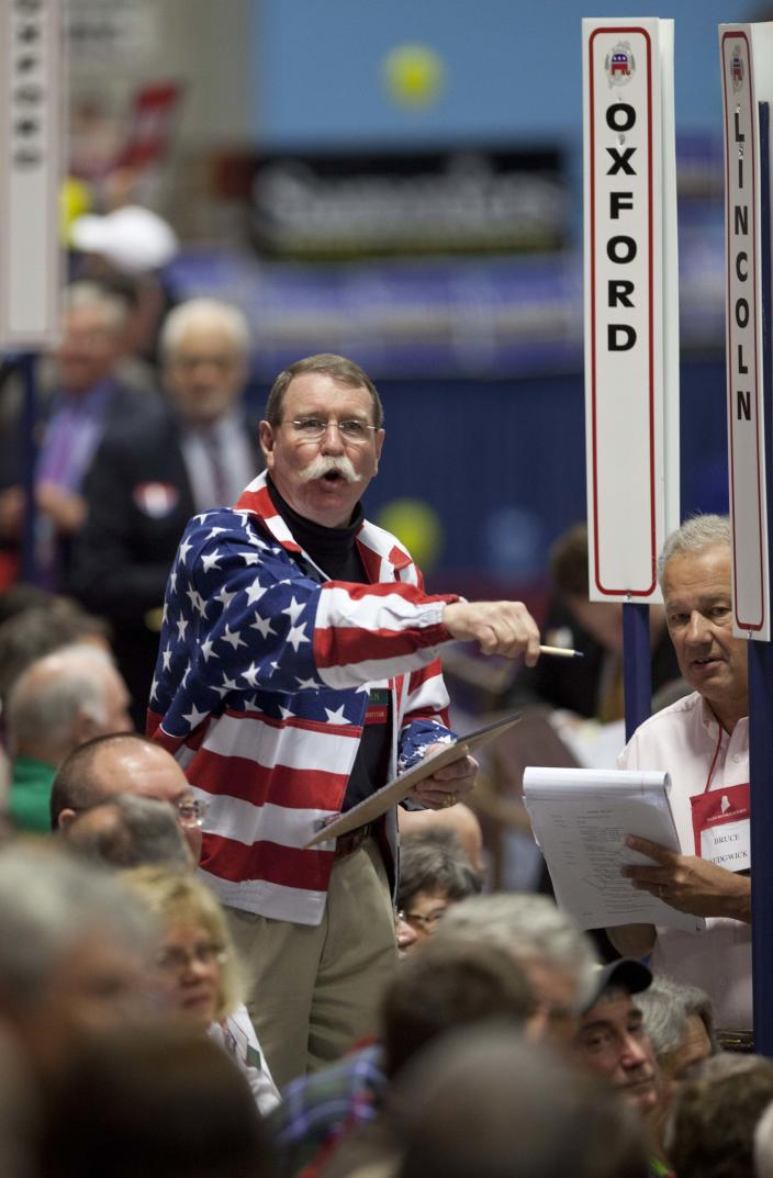 James Carlton of the Lincoln County State Committee counts votes of his county's delegates during the election of national committeemen at the Maine Republican Convention at the Augusta Civic Center in Augusta, Maine, Saturday, May 5, 2012. Ron Paul's supporters have taken the first step toward taking over the Republican State Convention this weekend as they narrowly elected a convention chairman. Paul supporter Brent Tweed was elected chairman with 1,118 votes, just four more than the mainstream candidate, Charles Cragin. A Paul supporter was also narrowly elected secretary. (AP Photo/Robert F. Bukaty)