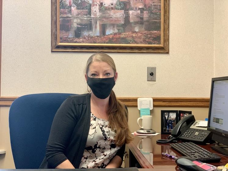 """Jami Colich, pictured in her office at a community bank in New Castle, Penn., said the division in her town is """"palpable."""""""