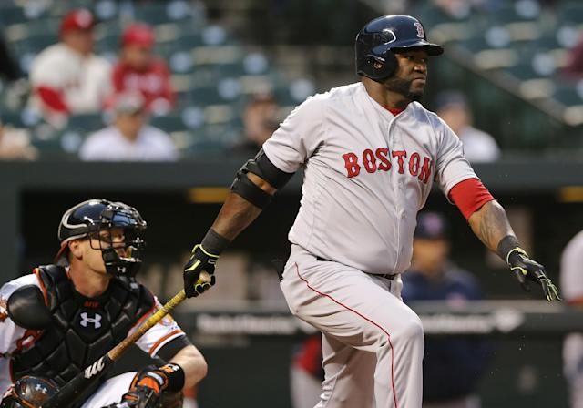 Boston Red Sox designated hitter David Ortiz, right, singles in the first inning of a baseball game against the Baltimore Orioles, Thursday, April 3, 2014, in Baltimore. (AP Photo/Patrick Semansky)
