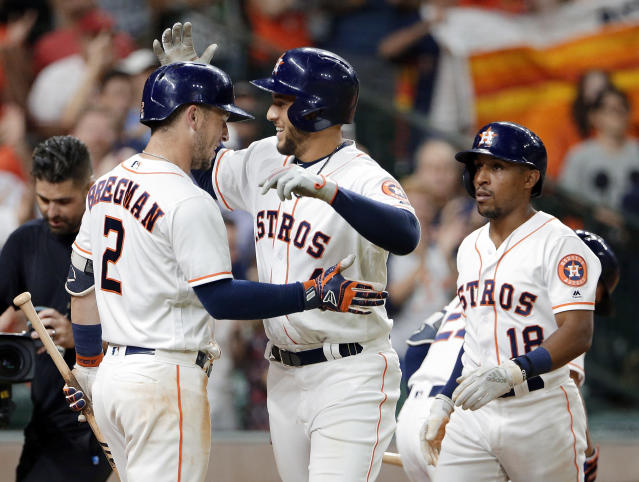 Houston Astros batter Alex Bregman (2) celebrates with George Springer, center, and Tony Kemp during the third inning of a baseball game against the Los Angeles Angels, Sunday, Sep. 2, 2018, in Houston. (AP Photo/Michael Wyke)