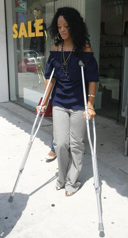 "Poor Rihanna! The R&B starlet injured her foot, but still managed hit up several trendy shops in Beverly Hills. You can't keep a good shopper down! London Entertainment/<a href=""http://www.splashnewsonline.com"" target=""new"">Splash News</a> - August 2, 2007"