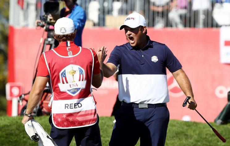 Patrick Reed celebrates his victory over Rory McIlroy. (Getty Images)