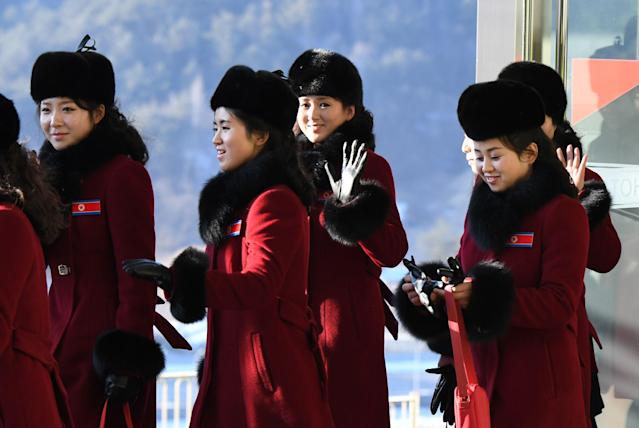 <p>North Korean cheerleaders walk to their accomodation at the Inje Speedium, a racetrack and hotel complex, in Inje, north of Pyeongchang, on February 7, 2018 ahead of the Pyeongchang Winter Olympic Games. </p>
