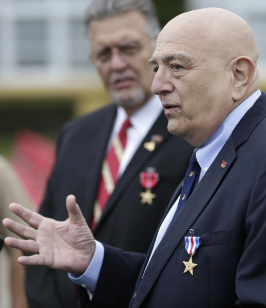 Retired Marines Joe Cordileone, right, and Robert Moffatt, left, speak during a ceremony to honor the two Vietnam War veterans at Marine Corps Recruit Depot Friday, Sept. 20, 2013, in San Diego. Cordileone was awarded the Silver Star Medal and Moffatt was awarded the Bronze Star Medal, 46 years after the two fought North Vietnamese army troops on a jungle hillside, and saw 75 percent of their unit be killed or wounded. (AP Photo/Gregory Bull)