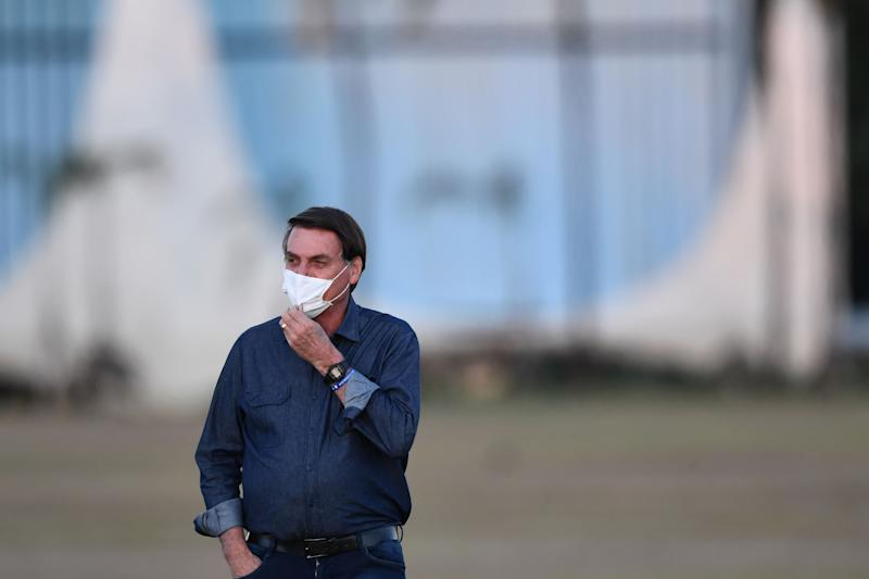 Brazilian President Jair Bolsonaro gestures while attending the flag unveiling ceremony at the Alvorada Palace in Brasilia, on July 15, 2020. - Brazil President Jair Bolsonaro tested positive for coronavirus again, CNN Brazil said on Wednesday, quoting the far right leader, who underwent a new test on Tuesday. (Photo by EVARISTO SA / AFP) (Photo by EVARISTO SA/AFP via Getty Images)