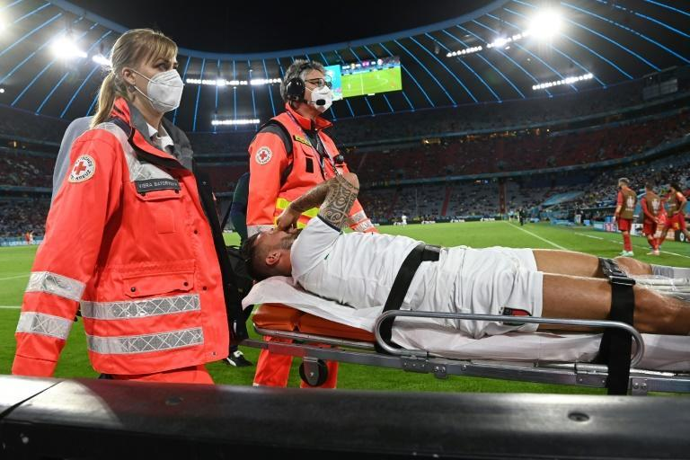 Italy defender Leonardo Spinazzola is stretchered off at the Allianz Arena