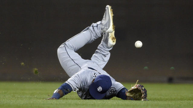 San Diego Padres right fielder Franmil Reyes (32) misses a ball that went for a triple by Washington Nationals' Michael Taylor during the sixth inning of a baseball game, Monday, May 21, 2018, in Washington. (AP Photo/Nick Wass)