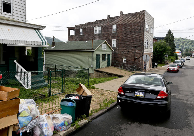This area on Grandview Ave. shown on Wednesday, June 20, 2018, is where witnesses say some boys fled from a traffic stop during a confrontation late Tuesday, in East Pittsburgh, Pa. Witnesses say a police officer fatally shot a 17-year-old in the incident. (AP Photo/Keith Srakocic)
