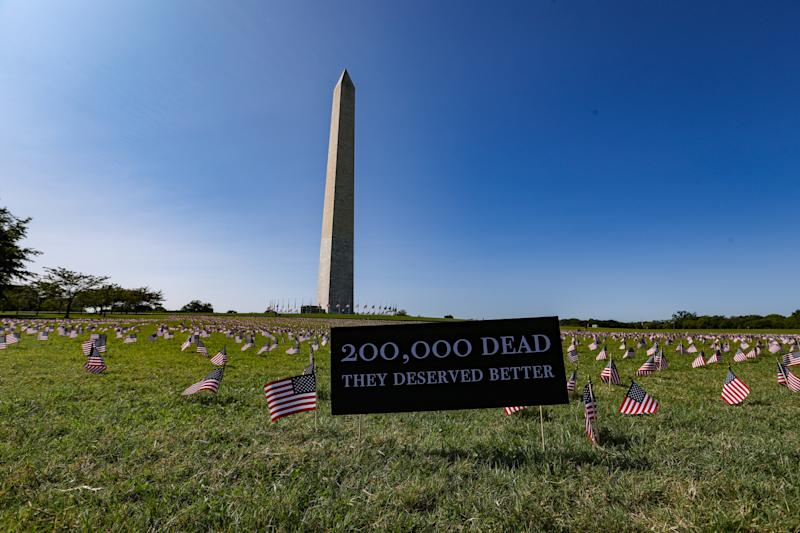 """People share tributes to loved ones who died of COVID-19 after Trump claims that """"the virus affects virtually nobody."""" (Photo: Getty Images)"""