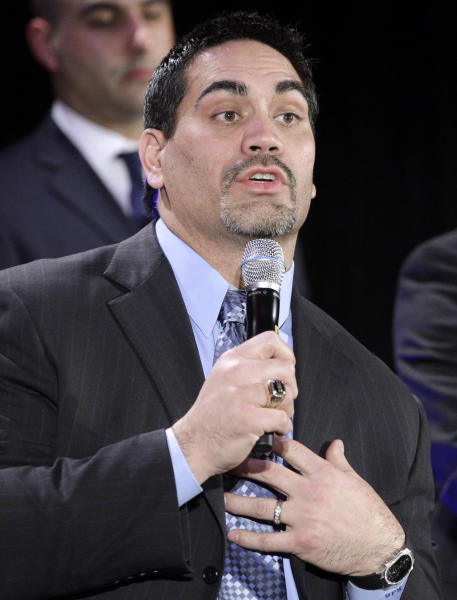 FILE - In this Feb. 3, 2011, file photo, Kevin Mawae, NFL Players Association president, responds to a question during a news conference in Dallas. Those hundreds of millions of dollars the NFL is ready to pay former players sound great, until you stretch it out over 20 years and divide it among thousands of people. Which is why some former players, like Mawae, and others think the league is getting off cheap in its tentative settlement with victims of concussion-related brain injuries (AP Photo/Tony Gutierrez, File)