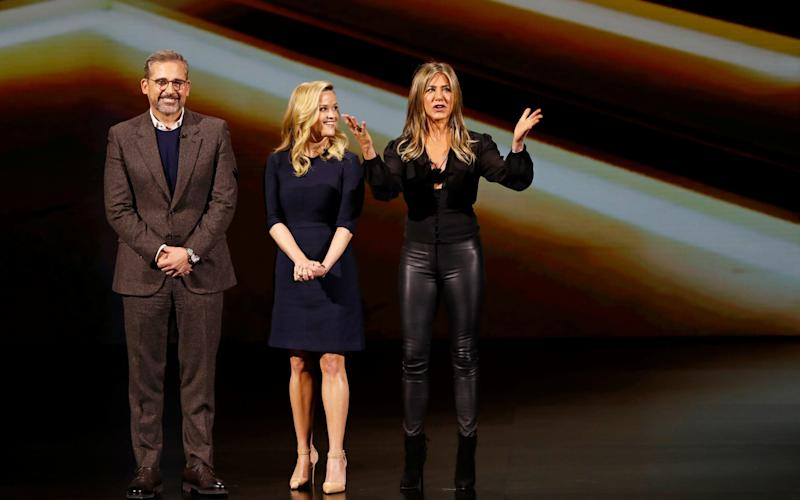 Actors Steve Carell, Reese Witherspoon and Jennifer Aniston speak during an Apple special event at the Steve Jobs Theater in Cupertino - REUTERS