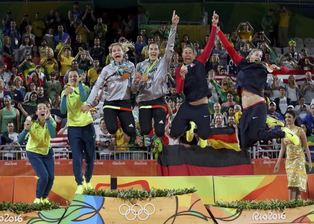 2016 Rio Olympics - Beach Volleyball - Women's Victory Ceremony - Beach Volleyball Arena - Rio de Janeiro, Brazil - 18/08/2016. Silver medalists Agatha Bednarczuk (BRA) of Brazil and Barbara Seixas Figueiredo (BRA) of Brazil, gold medalists Laura Ludwig (GER) of Germany and Kira Walkenhorst (GER) of Germany, and bronze medalists April Ross (USA) of USA and Kerri Walsh (USA) of USA celebrate. REUTERS/Adrees Latif FOR EDITORIAL USE ONLY. NOT FOR SALE FOR MARKETING OR ADVERTISING CAMPAIGNS.