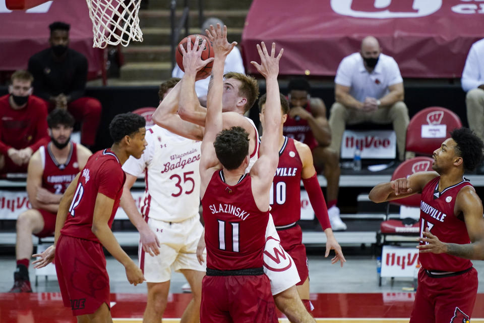 Wisconsin's Tyler Wahl (5) shoots against Louisville's Quinn Slazinski (11) during the first half of an NCAA college basketball game Saturday, Dec. 19, 2020, in Madison, Wis. (AP Photo/Andy Manis)