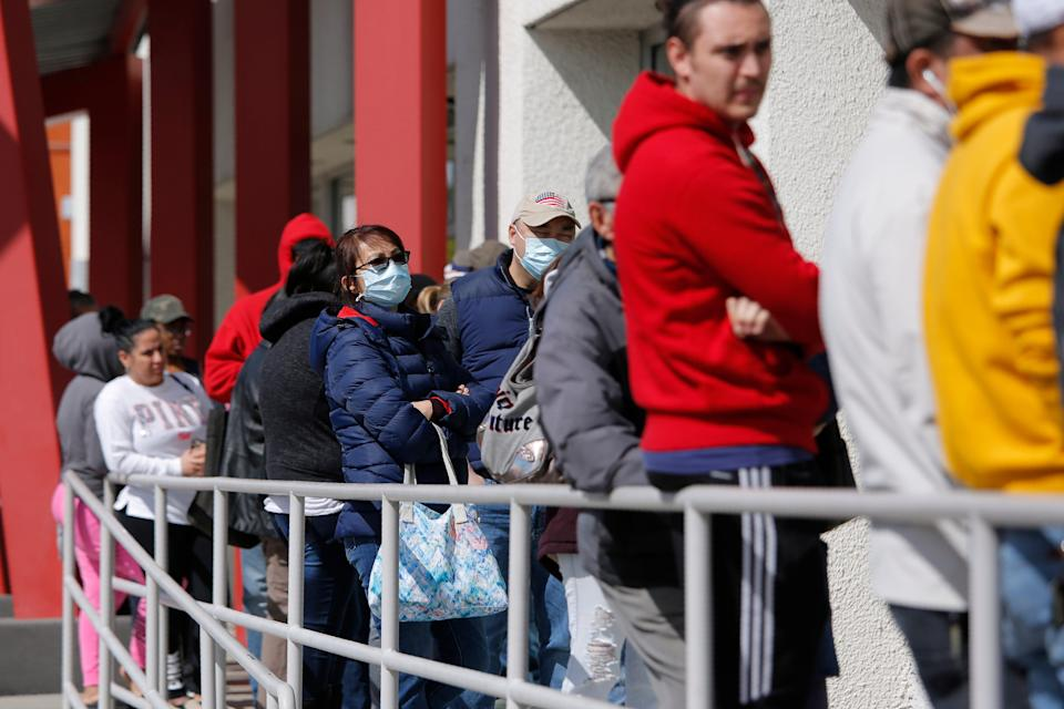 ID thieves are filing fake unemployment claims, taking advantage of the economic unrest during the COVID-19 crisis. In this March 17, 2020, file photo, people wait in line for help with unemployment benefits at the One-Stop Career Center in Las Vegas. T (AP Photo/John Locher, File)