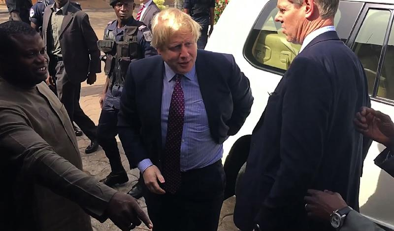 A video grab made from The Block Tv Gambia footage shows British Foreign Secretary Boris Johnson (C) arriving for a meeting in Banjul on February 14, 2017 (AFP Photo/STRINGER)