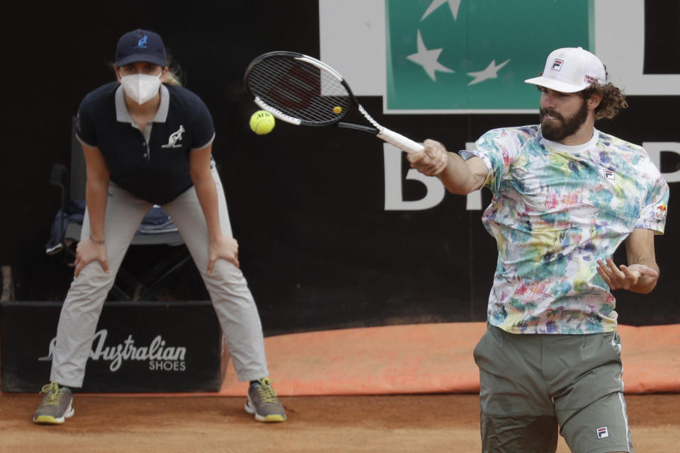 Reilly Opelka, of the United States, returns the ball to Argentina's Federico Delbonis during their quarter-final match at the Italian Open tennis tournament, in Rome, Friday, May 14, 2021. (AP Photo/Gregorio Borgia)