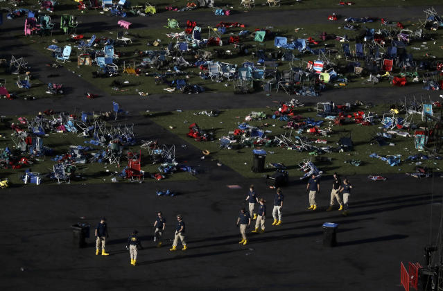 Investigators at the festival grounds across the street from the Mandalay Bay Resort and Casino on Tuesday. (Photo: Marcio Jose Sanchez/AP)