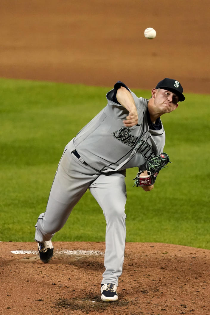 Seattle Mariners starting pitcher Chris Flexen throws during the second inning of a baseball game against the Kansas City Royals Friday, Sept. 17, 2021, in Kansas City, Mo. (AP Photo/Charlie Riedel)