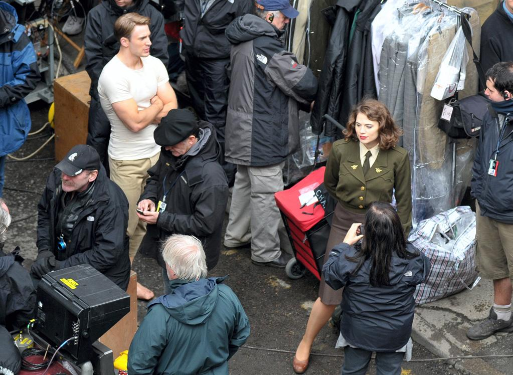 "Evans is joined in this shot by British actress <a href=""http://movies.yahoo.com/movie/contributor/1809735942"">Hayley Atwell</a>, who plays Captain America's wartime love interest Peggy Carter."