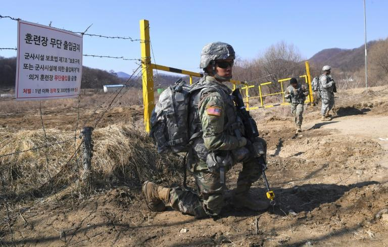 US soldiers take a position during their drill at a military training field in Paju, on March 7, 2017