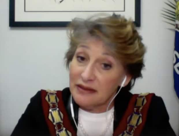 Hawkesbury Mayor Paula Assaly addresses a virtual meeting of council on March 8, 2021, where an integrity commissioner presented findings that she had interfered with staff duties. Assaly disputes the findings and is seeking a judicial review. (Youtube - image credit)