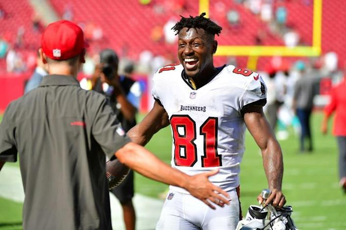 Tampa Bay's Antonio Brown celebrates after his record-setting day helped the Bucs to a 45-17 NFL victory over the Miami Dolphins (AFP/Julio Aguilar)