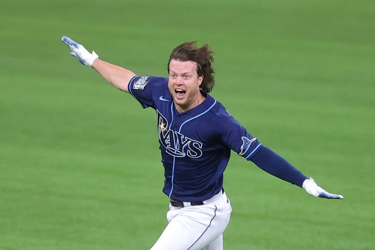 Brett Phillips of the Tampa Bay Rays celebrates after hitting a walkoff single in the ninth inning of the Rays' game-four victory over the Los Angeles Dodgers in the 2020 World Series