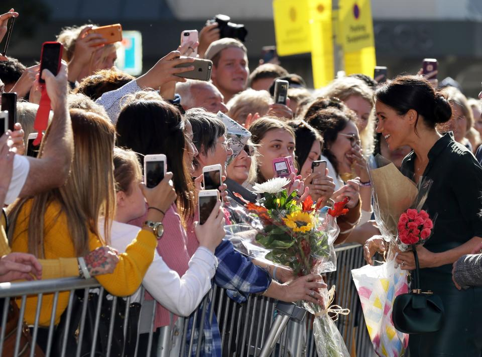 Britain's Meghan, Duchess of Sussex (R) speaks with well-wishers as she arrives to visit the Royal Pavilion in Brighton in East Sussex, southern England, on October 3, 2018. - The Duke and Duchess of Sussex made their first joint official visit to Sussex on October 3. Their Royal Highnesses paused to greet members of the public gathered at Pavilion Buildings on their way to the Royal Pavilion. (Photo by Tim IRELAND / POOL / AFP)        (Photo credit should read TIM IRELAND/AFP via Getty Images)