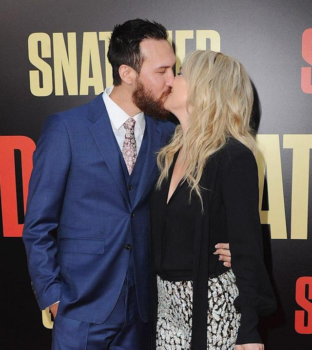 Kate Hudson and Danny Fujikawa brought on the PDA at the premiere of <em> Snatched.</em> (Photo: Jon Kopaloff/FilmMagic)