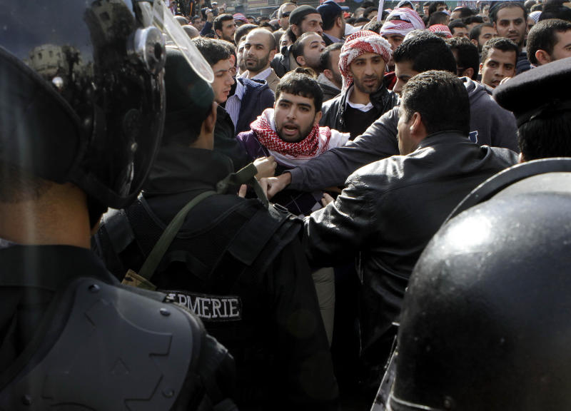 Jordanian riot police clash with protesters who tried to bypass a designated demonstration area after Friday prayers in Amman, Jordan, Friday, Nov. 16, 2012. Larger groups have demonstrated in Amman since the unrest sparked by fuel price hikes started three days ago, but Friday's march constituted the biggest single bloc yet to call for the end of the U.S.-backed monarch's regime. The crowd of some 2,500 also chanted slogans reminiscent of last year's uprisings in the region.(AP Photo/Raad Adayleh)