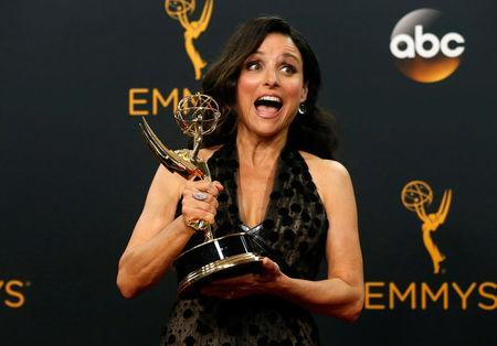 "FILE PHOTO -- Actress Julia Louis-Dreyfus poses backstage with her award for Outstanding Lead Actress In A Comedy Series for her role in HBO's ""Veep"" at the 68th Primetime Emmy Awards in Los Angeles, California U.S., September 18, 2016. REUTERS/Mario Anzuoni/File Photo"