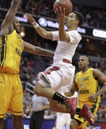 Maryland's Seth Allen, center, shoots the ball against George Mason's Erik Copes (4) during first half of an NCAA college basketball game at the 18th Annual BB&T Classic in Washington, Sunday, Dec. 2, 2012. (AP Photo/Luis M. Alvarez)