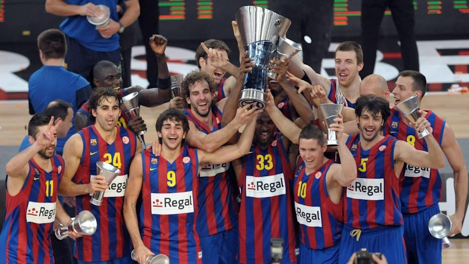 Regal Barcelona's players celebrate with | BERTRAND LANGLOIS/Getty Images