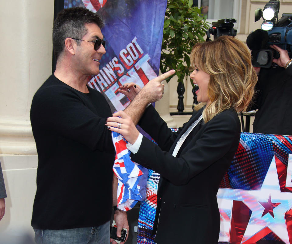 LONDON, ENGLAND - APRIL 11:  Amanda Holden and Simon Cowell attend the press launch for the new series of 'Britain's Got Talent' at ICA on April 11, 2013 in London, England.  (Photo by Mike Marsland/WireImage)