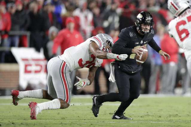 Ohio State linebacker Malik Harrison (39) sacks Purdue quarterback David Blough (11) during the first half of an NCAA college football game in West Lafayette, Ind., Saturday, Oct. 20, 2018. (AP Photo/Michael Conroy)
