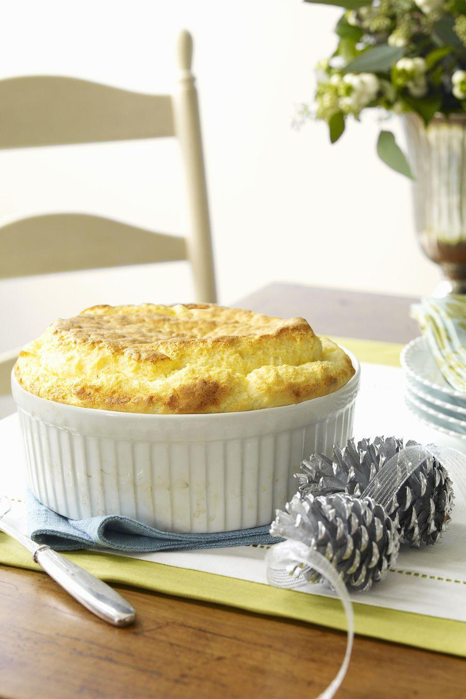 """<p>These mini soufflé dishes are elegant, light, and intimate.</p><p><strong><a href=""""https://www.countryliving.com/food-drinks/recipes/a1872/cheese-grits-corn-pudding-3997/"""" rel=""""nofollow noopener"""" target=""""_blank"""" data-ylk=""""slk:Get the recipe"""" class=""""link rapid-noclick-resp"""">Get the recipe</a>.</strong></p>"""