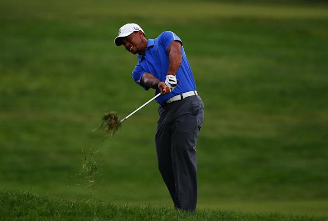 ARDMORE, PA - JUNE 13: Tiger Woods of the United States hits his second shot on the first hole during Round One of the 113th U.S. Open at Merion Golf Club on June 13, 2013 in Ardmore, Pennsylvania. (Photo by Rob Carr/Getty Images)