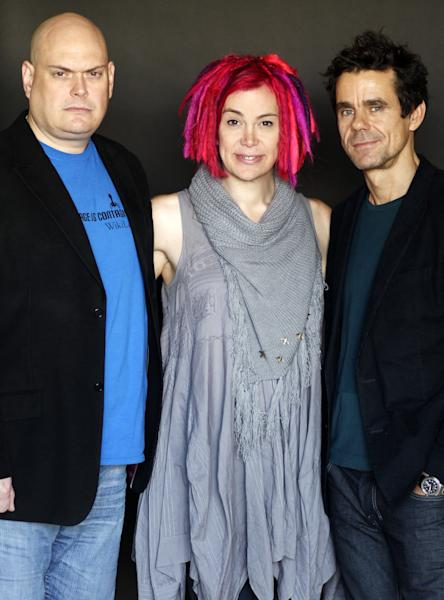 "This Oct. 14, 2012 photo shows directors- screenwriters Andy Wachowski, left, Lana Wachowski, center, and Tom Tykwer, from the upcoming film ""Cloud Atlas"", in Beverly Hills, Calif. The film is an epic of shifting genres and intersecting souls that features Tom Hanks, Halle Berry, Jim Broadbent, Hugh Grant, Hugo Weaving, Ben Whishaw, Jim Sturgess, James D'Arcy, Doona Bae, Keith David, Sarandon and others in multiple roles spanning the centuries. (Photo by Matt Sayles/Invision/AP)"